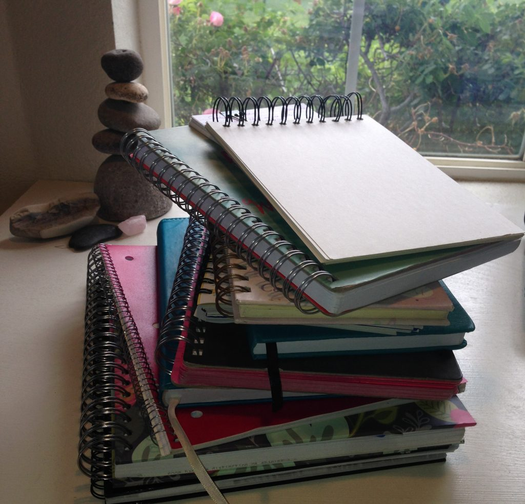 a stack of journals for writing by hand